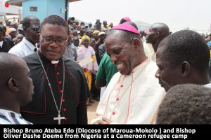 bishop-bruno-ateba-edo-diocese-of-maroua-mokolo-and-bishop-oliver-dashe-doeme-from-nigeria-at-a-cameroon-refugee-campv3